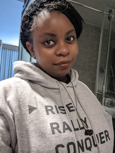"""briana thompson wearing a """"rise rally conquer"""" hoodie"""