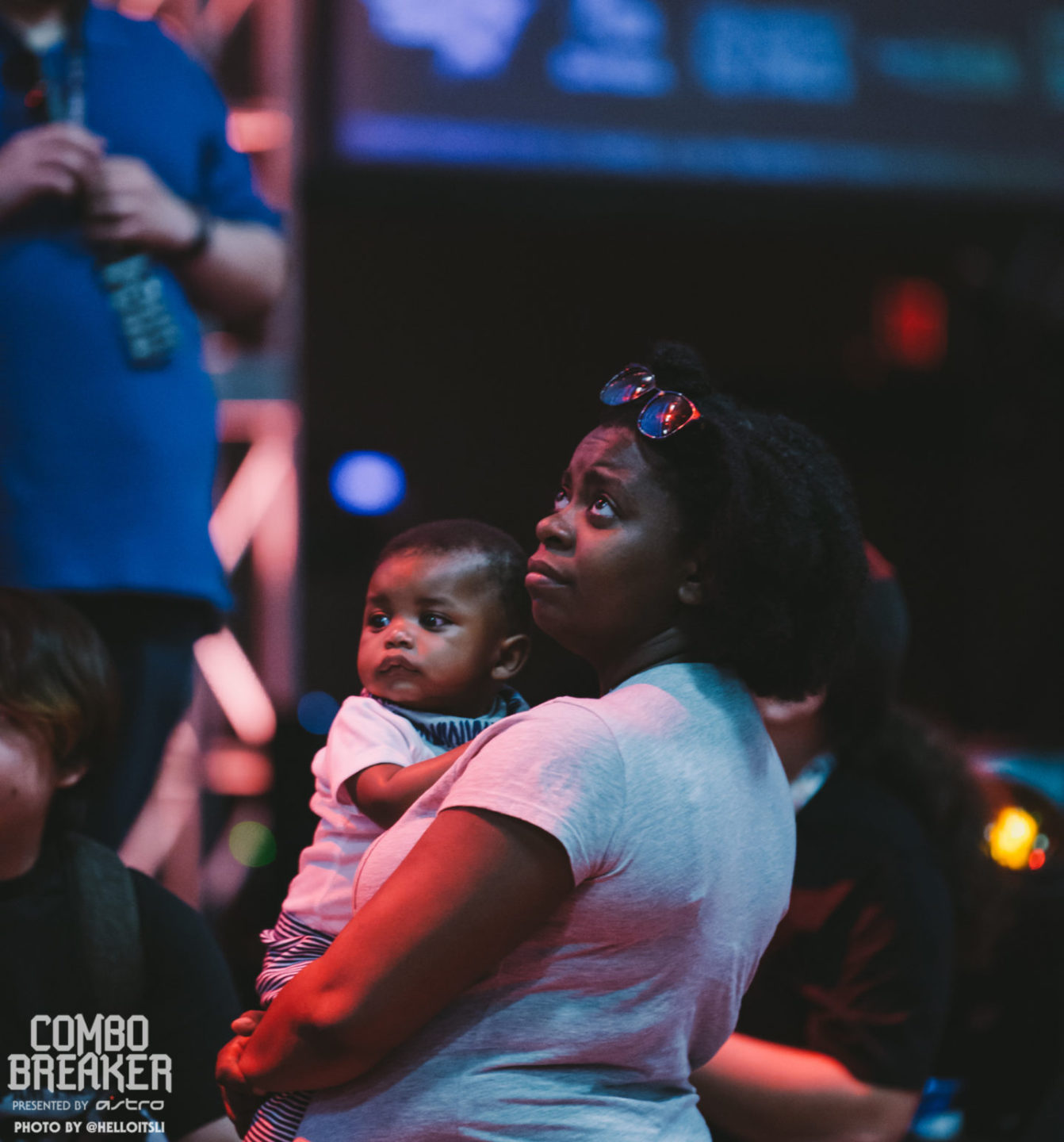 briana thompson holding her son, michael, at combo breaker