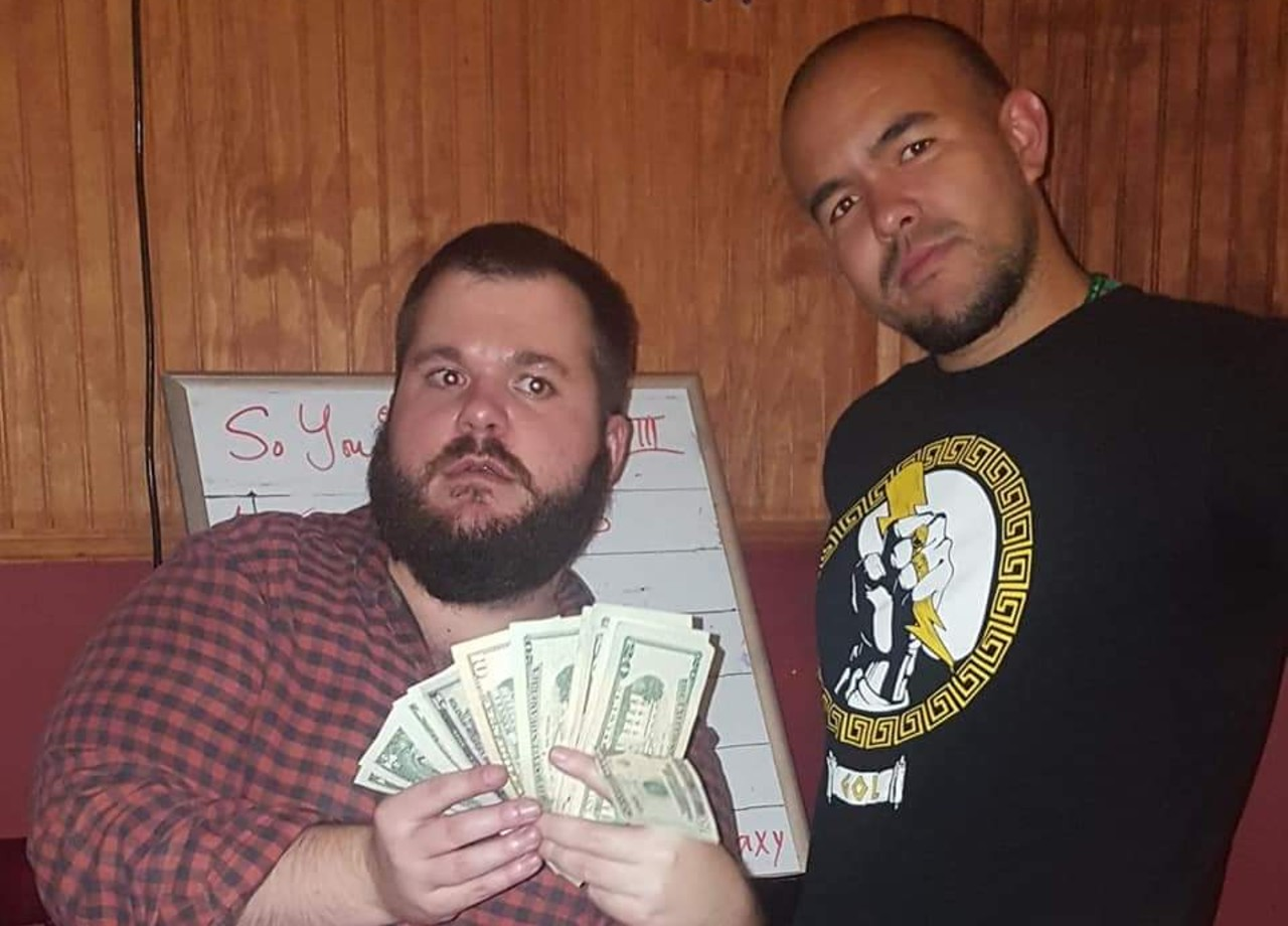 louisiana tournament organizer jelly, who's holding a wad of cash and standing with the late krucial b